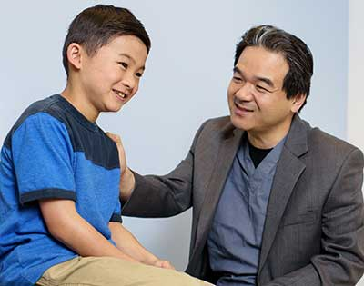 Dr. Maeda with young patient at Lucile Packard Children's Hospital Stanford Pediatric Bloodless Surgery Program