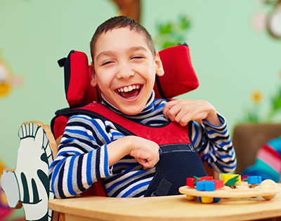 Cheerful boy with disability