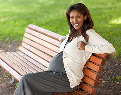 Pregnant mom sitting on a bench
