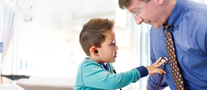 Stanford Children's Health doctor with young patient using a stethoscope