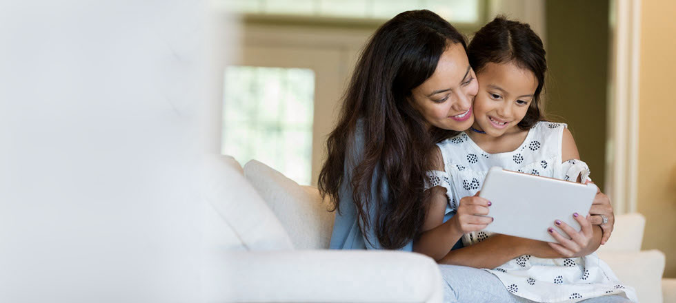 Women with daughter on tablet