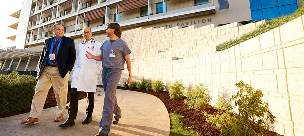 Drs. Concepcion, Cornfield and Sidell walking in front of the new Lucile Packard Children's Hospital Stanford in Palo Alto