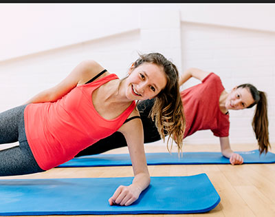 Two Women Side Planking Spine Program