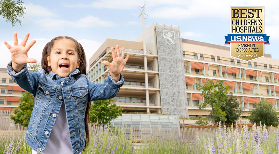 Little girl in front of Lucile Packard Children's Hospital Stanford in Palo Alto, California