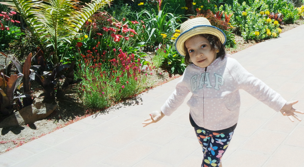 Girl wearing hat in garden
