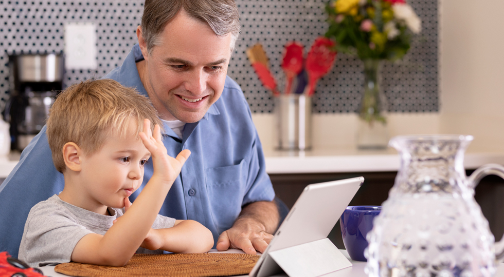 Dad and son using a tablet