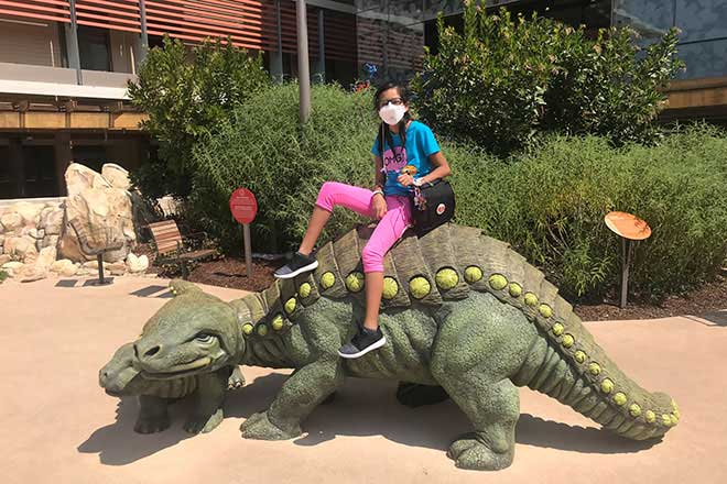 Lizneidy Serratos sitting on dinosaur