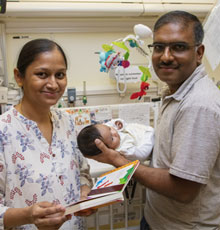 Parents read to baby in NICU at Lucile Packard Children's Hospital Stanford