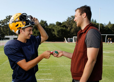 Bay area football teams outfitted with mouthguards that measure head motion
