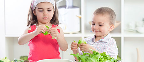 Two kids preparing a meal