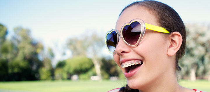 Teenager wearing heart shaped sunglasses