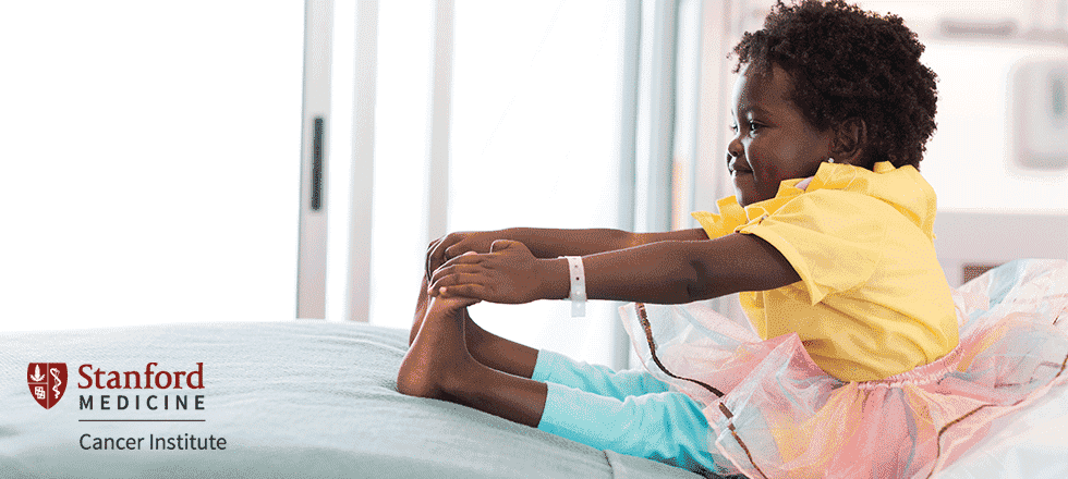 Young patient reaching for her toes in a ballerina tutu