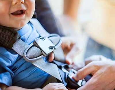 baby being buckled in car seat at Stanford Children's Health