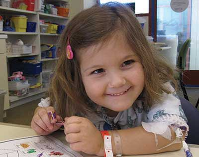 Girl coloring at Lucile Packard Children's Hospital Stanford Hospital School