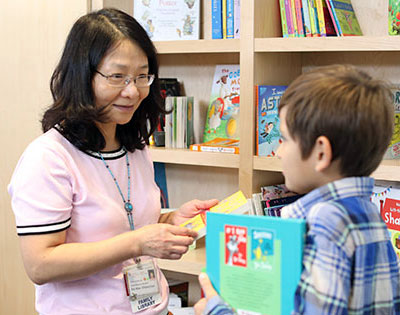 Lucile Packard Children's Hospital Stanford Librarian with young patient