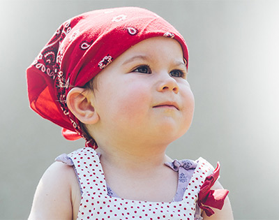 Neuro-Oncology - girl with bandana on head