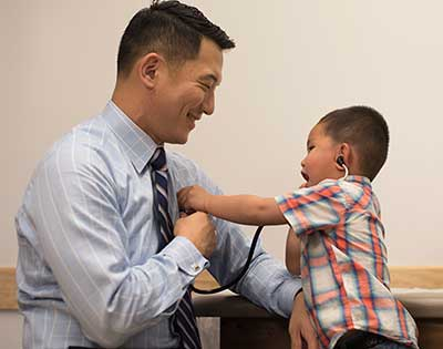Stanford Children's Health pediatrician with young patient in our Emeryville location