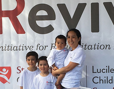 Family at Revive booth