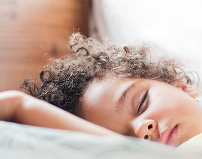 Child sleeping on a pillow