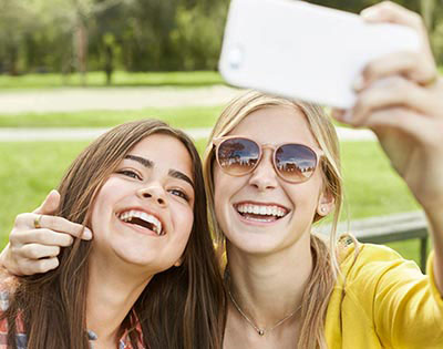 Two teens taking selfies