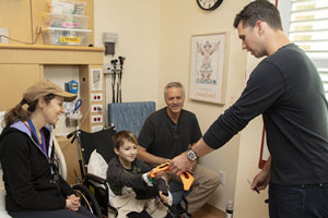 San Francisco Giant Buster Posey visiting a young patient at Lucile Packard Children's Hospital Stanford.